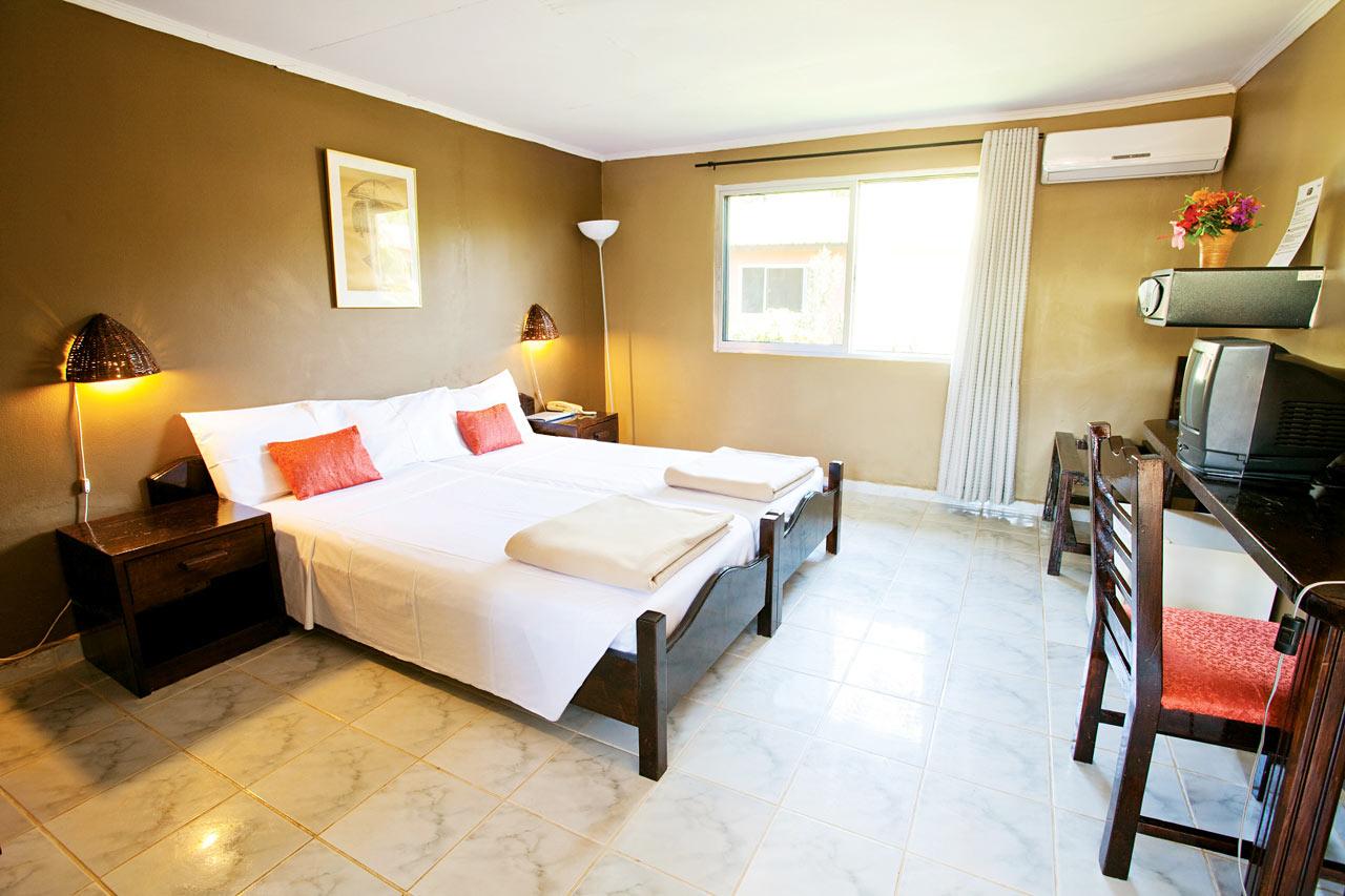 Esimerkki kaksion makuuhuoneesta sekä kahden hengen huoneesta